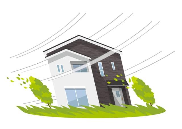 強い風に耐える家